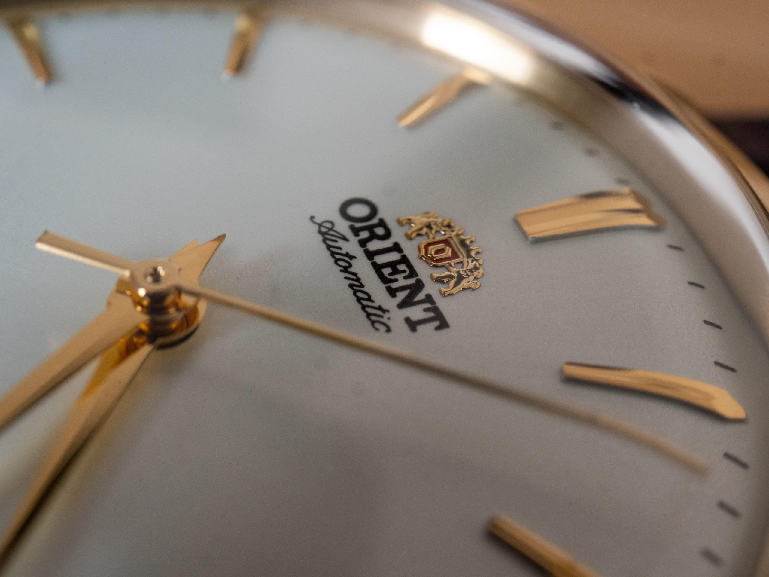 Orient Bambino 36 dial logo